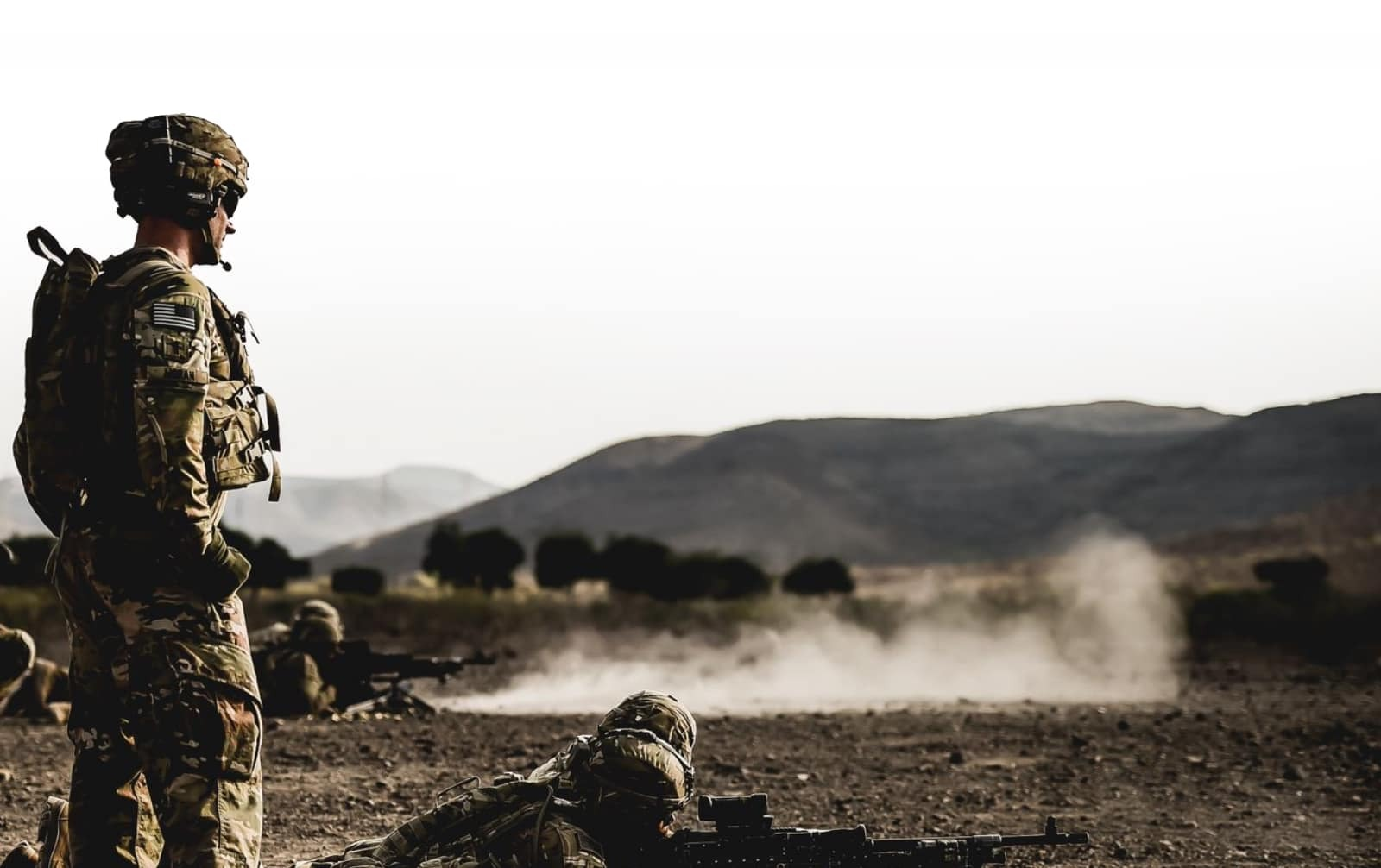 military member on field in combat