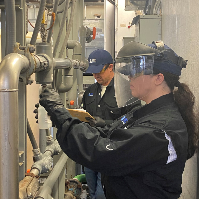 Two workers work in water filtration