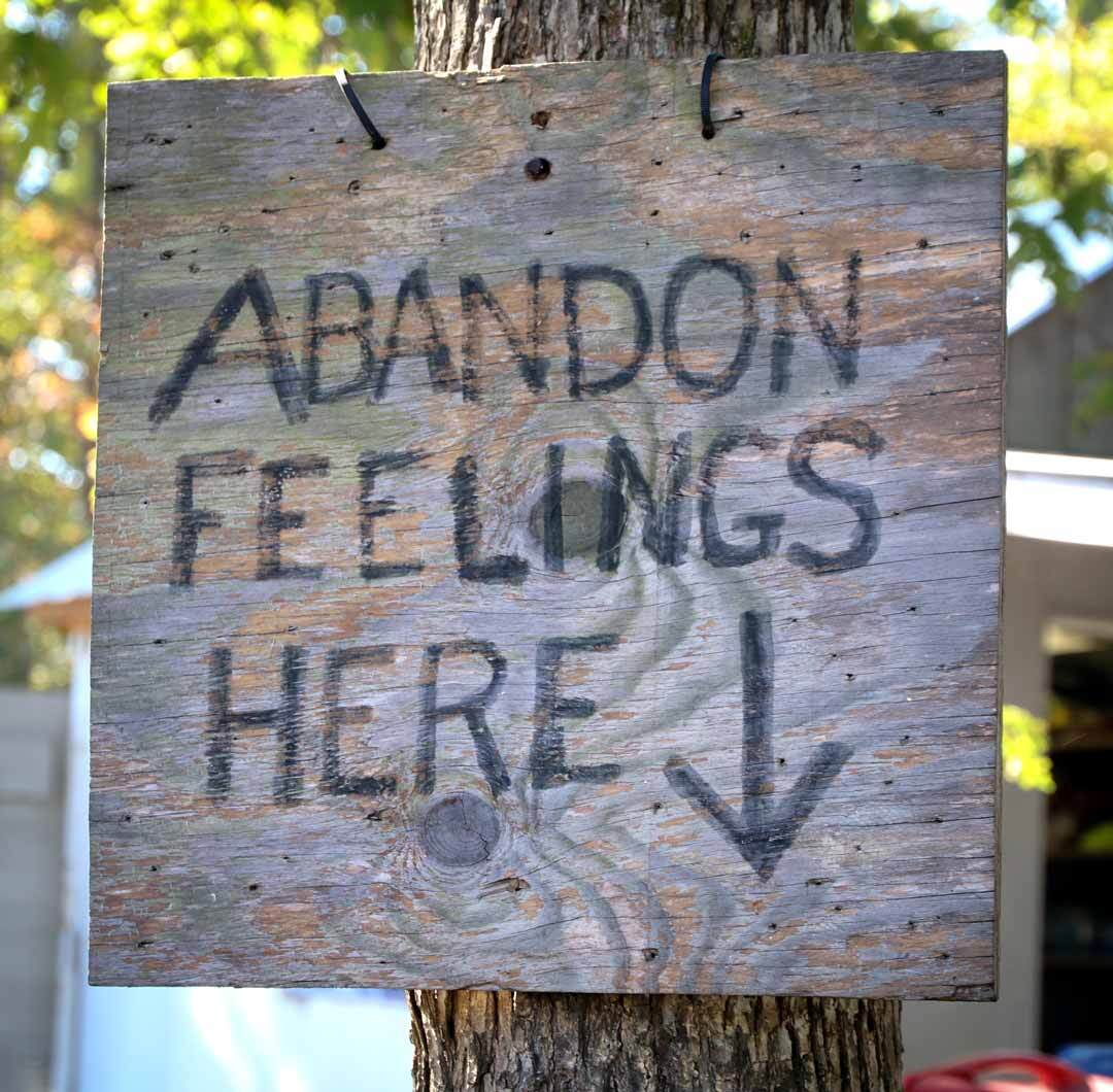sign that says abandon feelings here