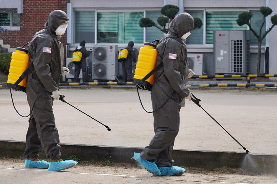 workers disinfect street