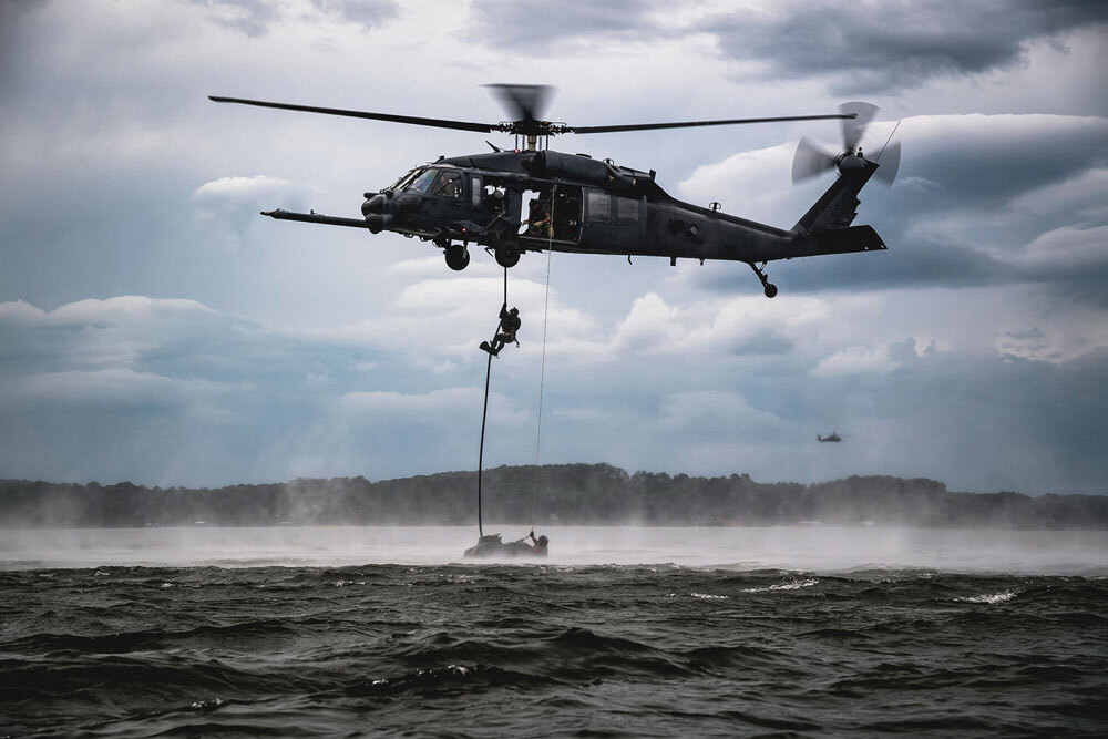military helicopter above water