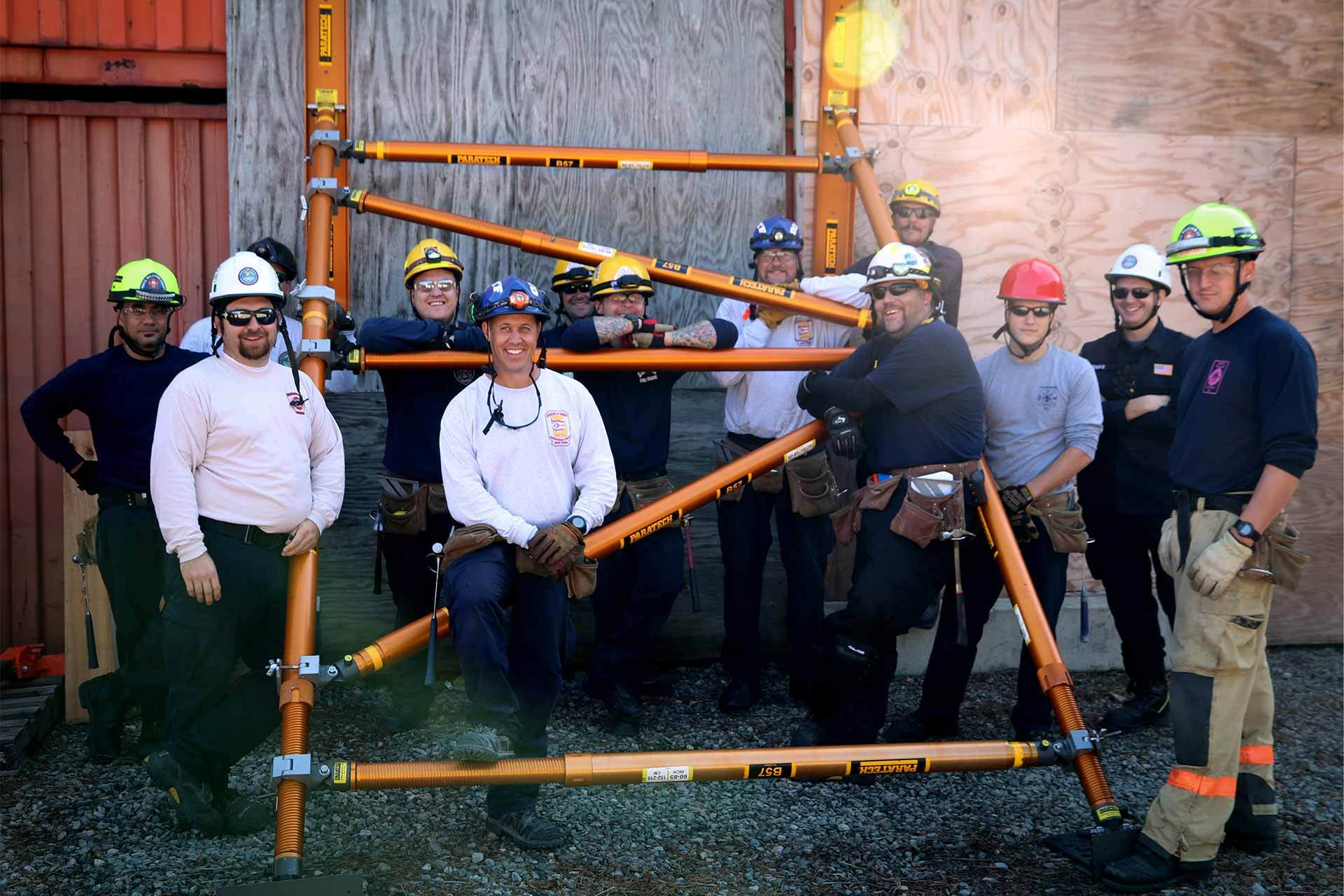construction workers pose in front of project
