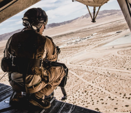 army man look down from plane