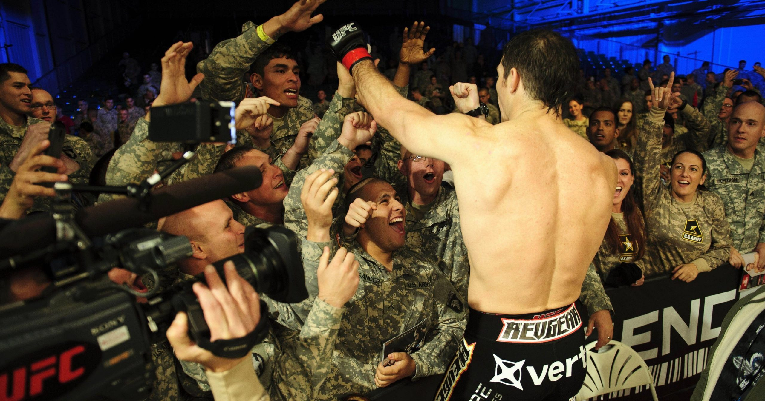 army members cheer on boxer